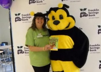 FSB SmileSquad member with FSB's Buzzy Bee